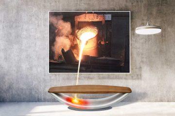 """Bildmontage flüssiges Eisen fließt von einem Wandbild auf die Sitzbank """"Fuego"""""""
